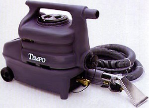 "This compact rugged spot cleaner was designed for powerful extraction yet weighs only 23 pounds! Use the Tempo spot extractor for touch-ups and spot removal between scheduled carpet cleanings, and in those hard-to-reach places where the bigger extractors just can't fit.•2 stage vacuum motor•55 PSI pump•85"" water lift•23 lbs.•Rotationally molded polyethylene body•1 1/2 gallon capacity•25' 16/3 power cord•8' vacuum and solution hose assembly with 3"" stainless steel upholstery tool."